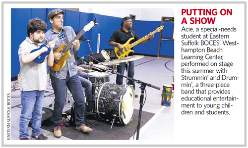 "A news clipping that says ""Putting on a Show"" with a picture of a student and a three piece band"