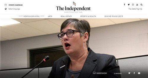 The first screen grab of a news article from The Independent East End that shows a woman speaking at a microphone