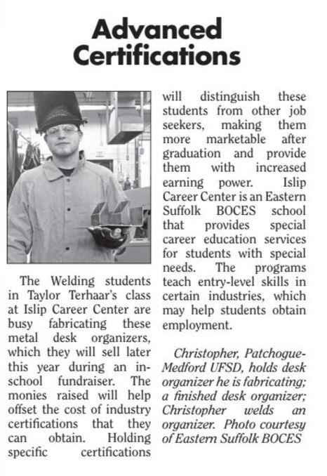 newspaper article with image of student holding a desk organizer