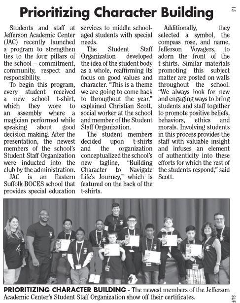 article with image of students and staff