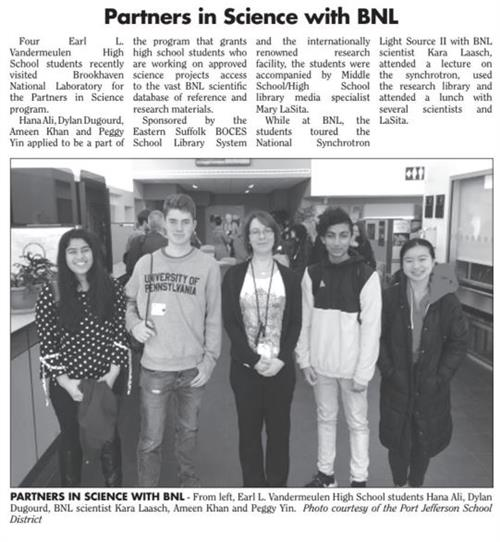 newspaper article with group shot of students