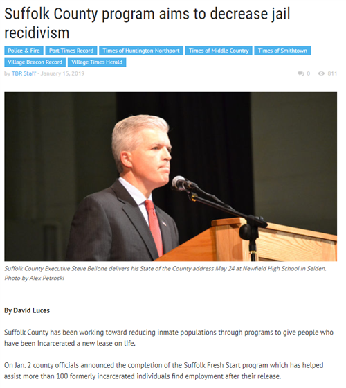 A picture of the first page of a news article with a picture of Suffolk County Executive, Steve Bellone at a microphone