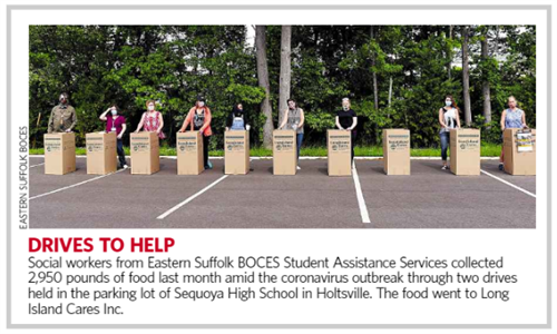 "A picture showing 9 people, standing behind donation boxes that says ""Drives to Help"""