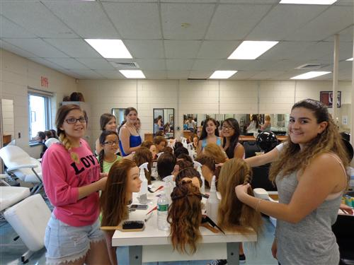 Cosmetology students cutting hair