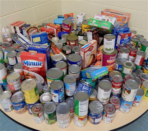 Large pile of canned goods