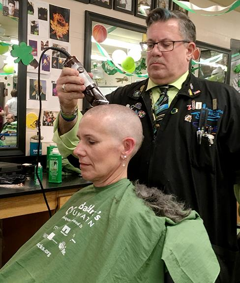 Dr. Luzt having her head shaved