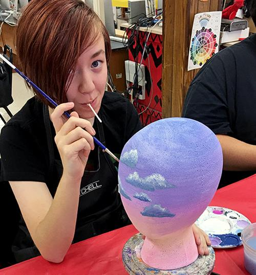 Students Decorate and Donate Wig Stands for Cancer Patients