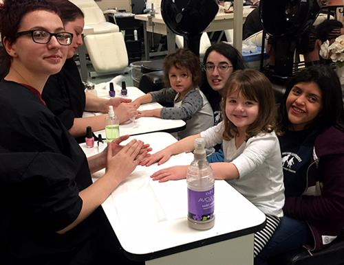 Group of students and preschoolers getting manicures