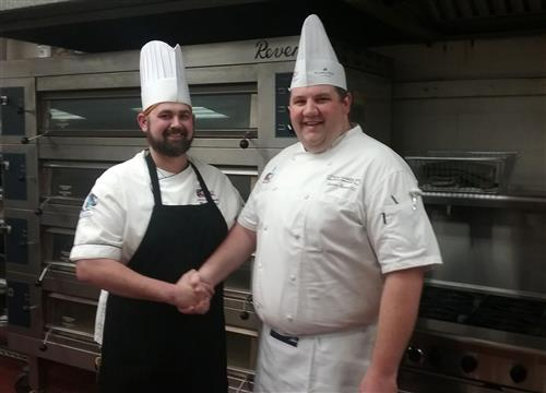 Chef Elijah Dalager and Chef Andrew Greene shake hands and wish each other good luck prior to the start of the competition.