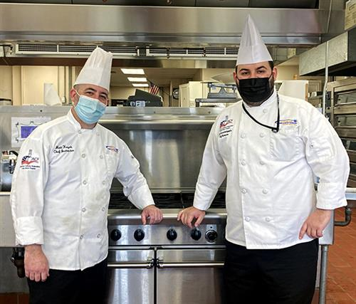 two culinary arts teachers in kitchen whites