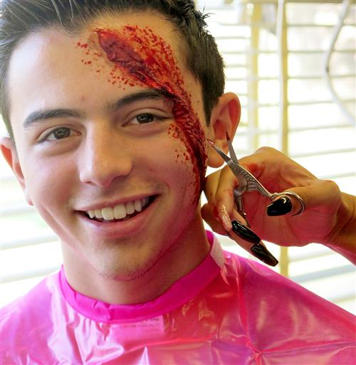 Student applying special effects makeup