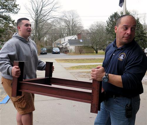 Student carries table frame