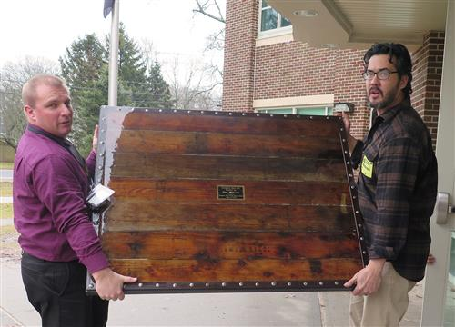 Two people carry the tabletop