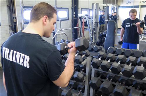 Working out in the Certified Personal Training Program.