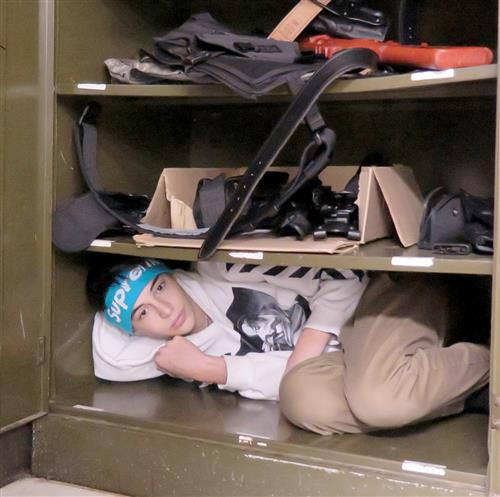 Student hiding in a metal supply cabinet