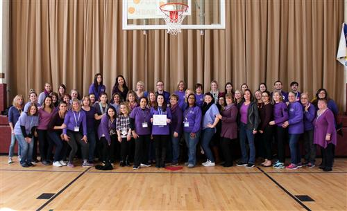 Group shot of staff wearing purple to support PS I Love You Day.