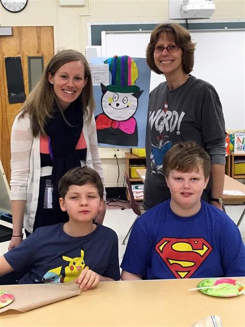 Group shot of Ms. Henry and Ms. Siracusano with two students.