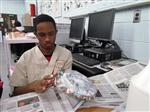 Longwood CSD student Emilo shows attention to detail when creating his Mod Podge piece.