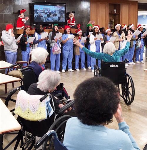 Nursing students sing at nursing home