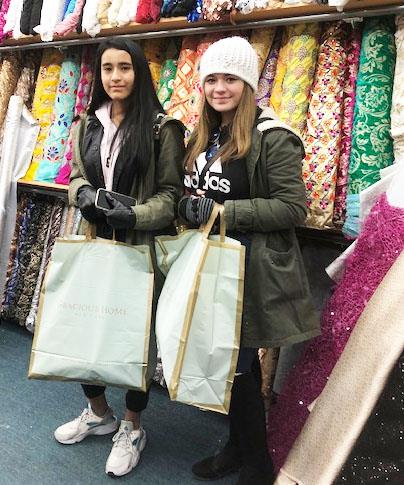 Two fashion students shop for fabric